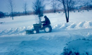 DAD WORKING THE SNOW
